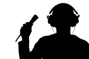 singer wearing headphones