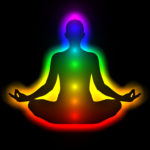 7 chakras glowing in figure in meditation pose