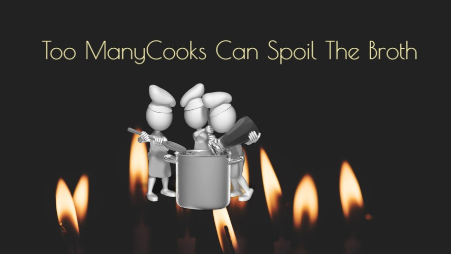 3 cooks at a pot over a fire
