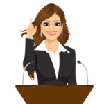 female orator standing behind a podium with microphones. Speaker