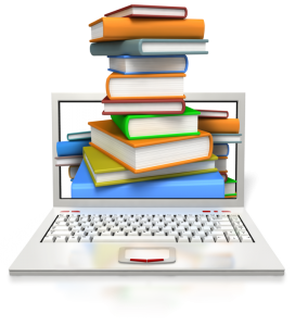 technical writing- stack of books and a laptop computer for social media posts