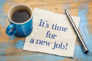 It is time for a new job - handwriting on a napkin with a blue cup of espresso coffee