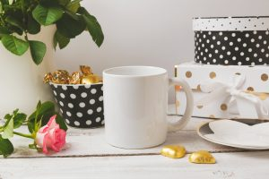 Black and white polka dot and plain Coffee cup with glamour and elegant feminine objects