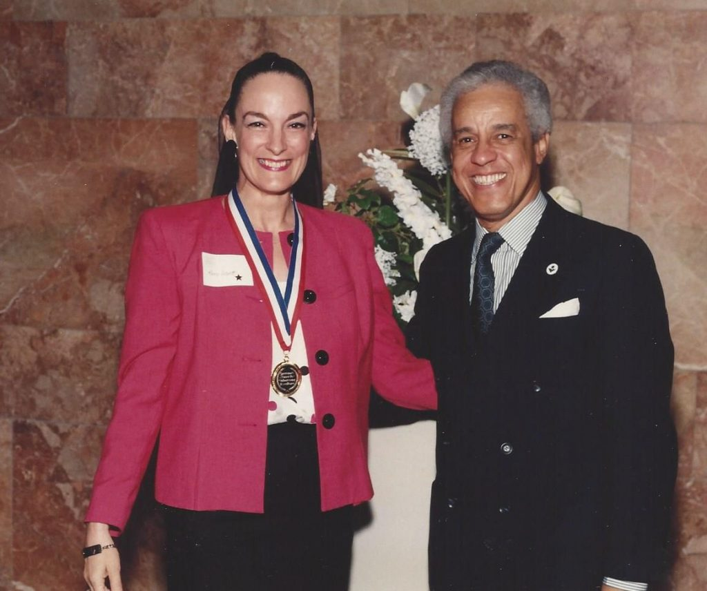 Nancy getting Gold Medal Award from Virginia Governor Wilder