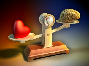 scales balancing heart on the left and brain on the right