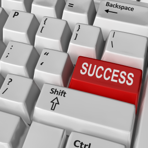 "keyboard with red key saying ""success"""