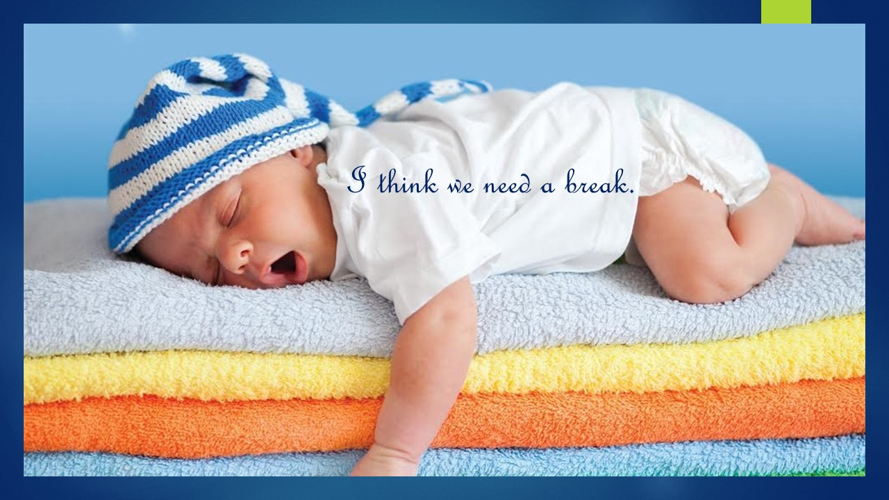 Baby in cap lying on yellow, orange, and blue towels worcs I think we need a break!