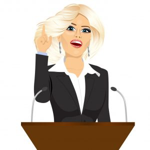 Woman in business dress speaking from a podium about politics and social issues