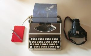 smart phone, typewriter, and camera for content creation
