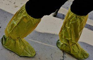 yellow rubber boots by Robert Allmann