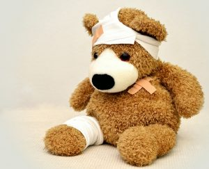 photo of bandaged teddy bear by Conger Design