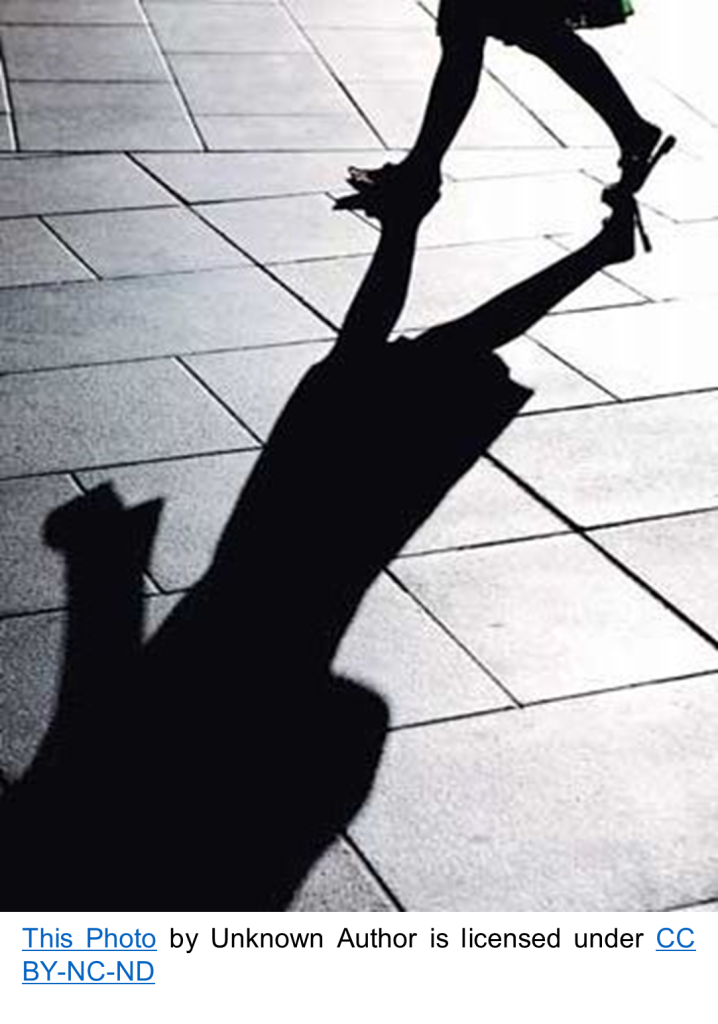 shadow and silhouette of woman walking away by unknown photographer