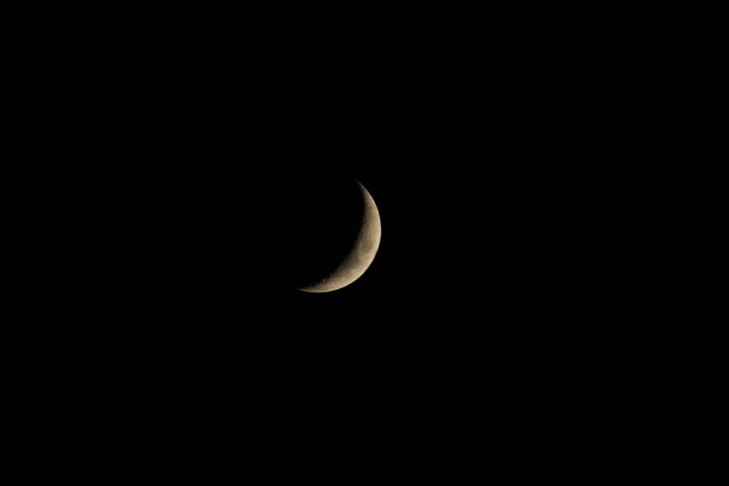 sliver of a moon- photo by-Khusen-Rustamov