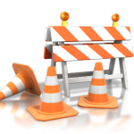 orange and white cones and barricades for under construction