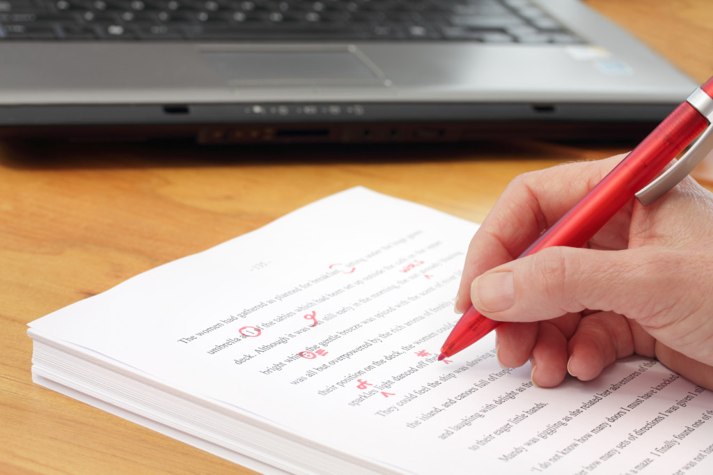 http://www.dreamstime.com/stock-image-red-pen-proofreading-manuscript-laptop-image21643751