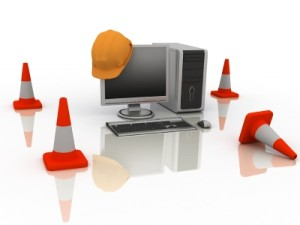 orange cones and computer screen with hard hat on it signifying The Occasional Poet site is under construction